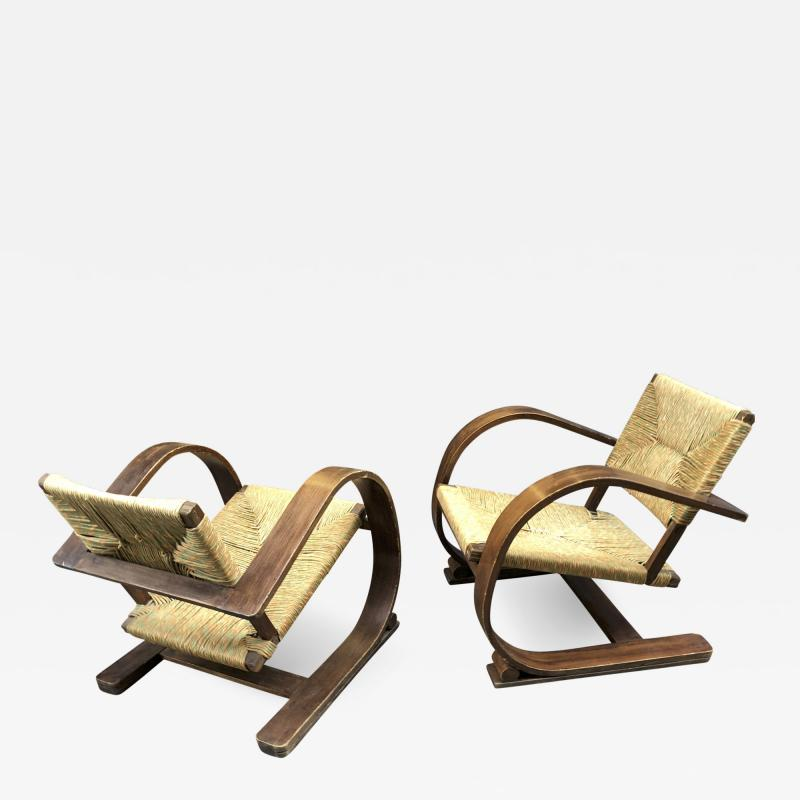 Adrien Audoux Frida Minet Audoux Minet pair of bent wood lounge chair with a rare rush cover
