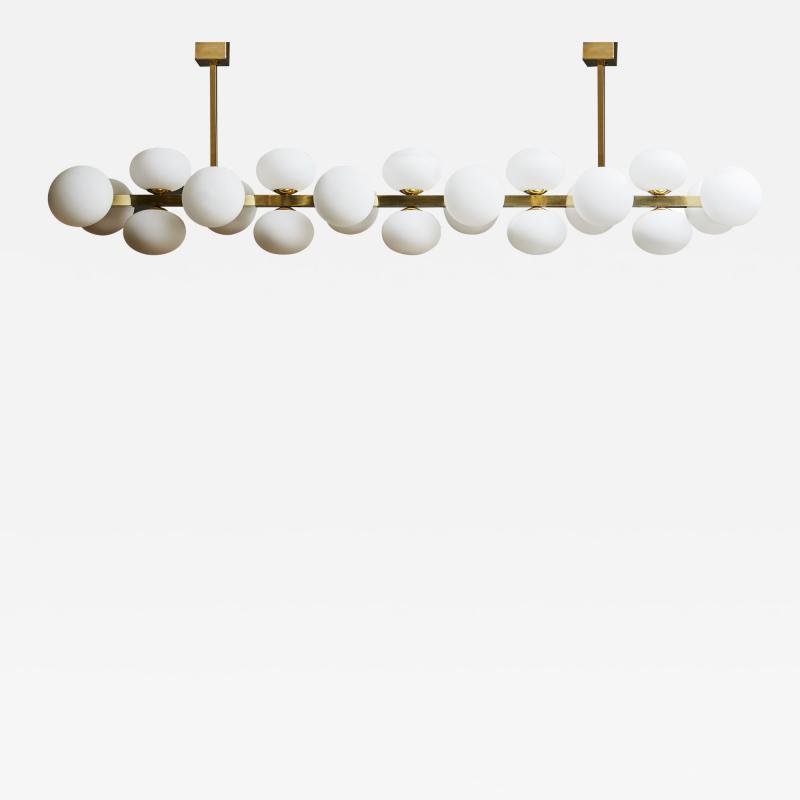 Glustin Luminaires Wide Brass Chandelier with Globes
