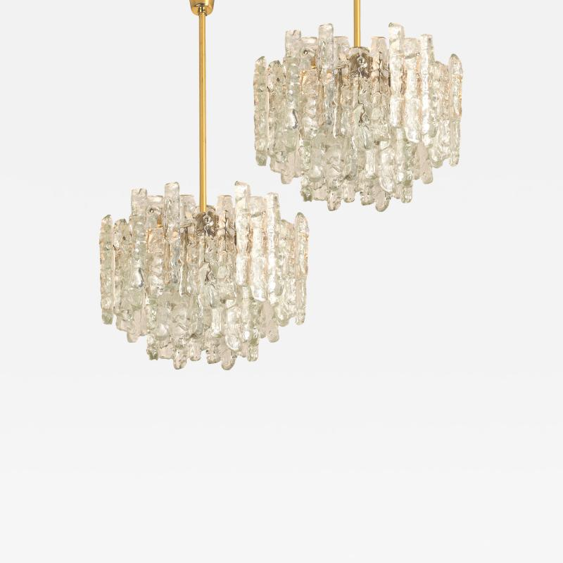 Kalmar Lighting Pair of Modern Kalmar Brass Two Tiered Ice Glass Pedant Chandeliers 1970s