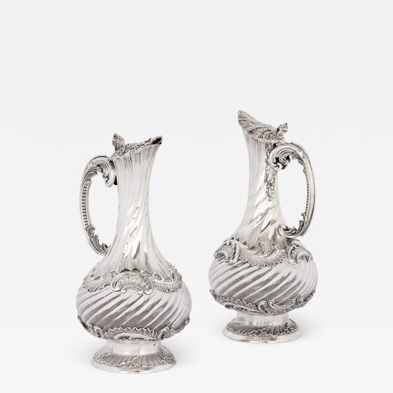 Lancon Pair of French Rococo style silver and crystal jugs
