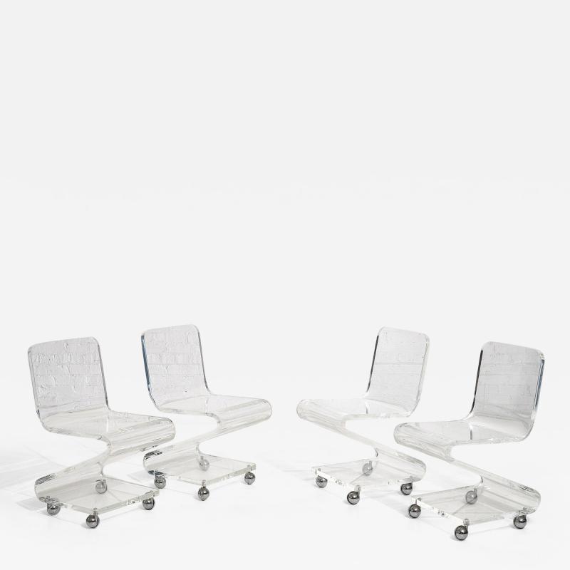 Les Prismatiques Lucite Chairs on Casters circa 1970