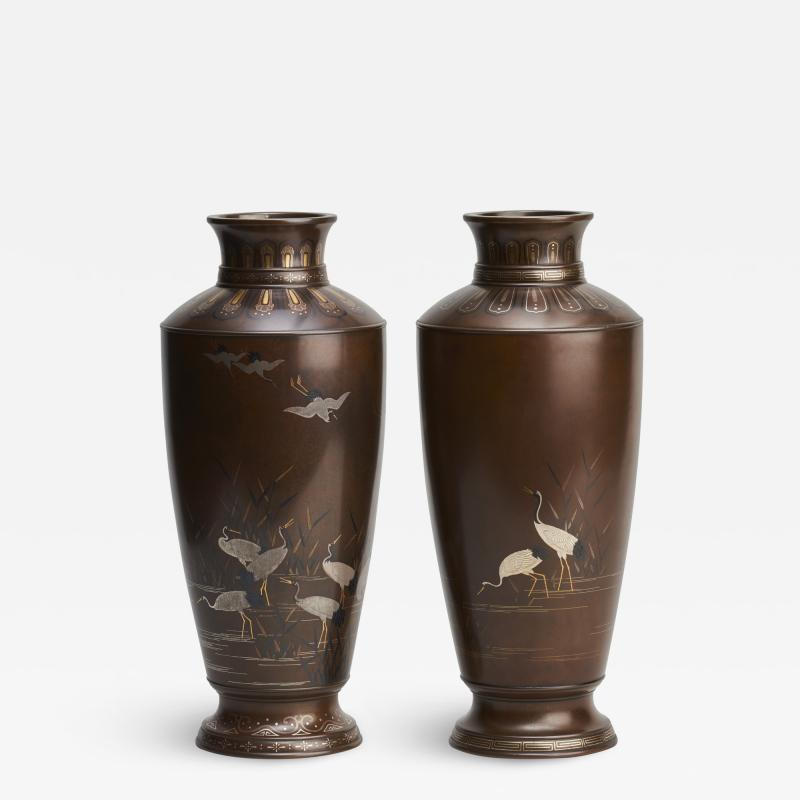 Nogawa A pair of stylish Meiji Period Japanese bronze vases with crane decoration