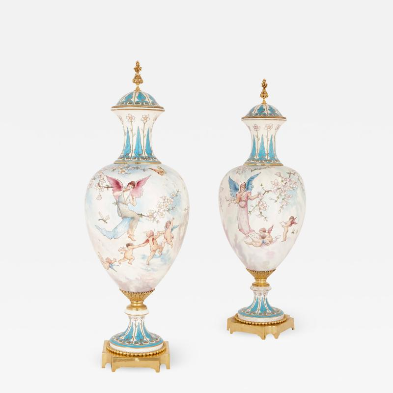 Sevres Manufacture Nationale de S vres Two large gilt bronze mounted Rococo style white porcelain vases