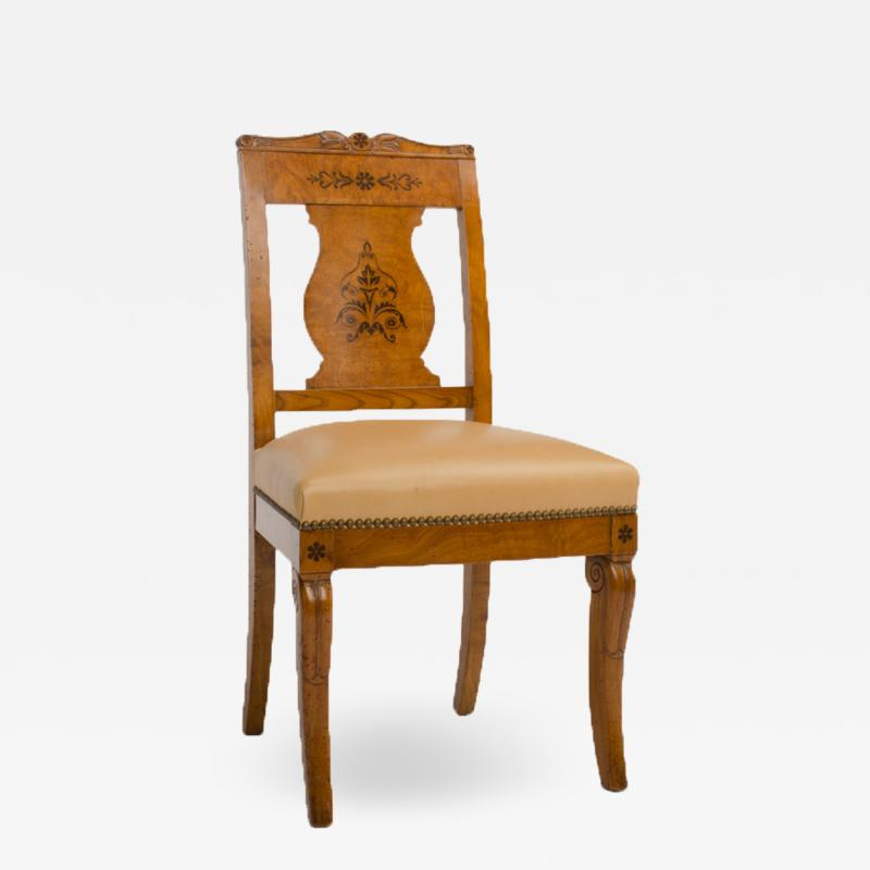 A 19th Century burlwood chair in the Biedermeier style