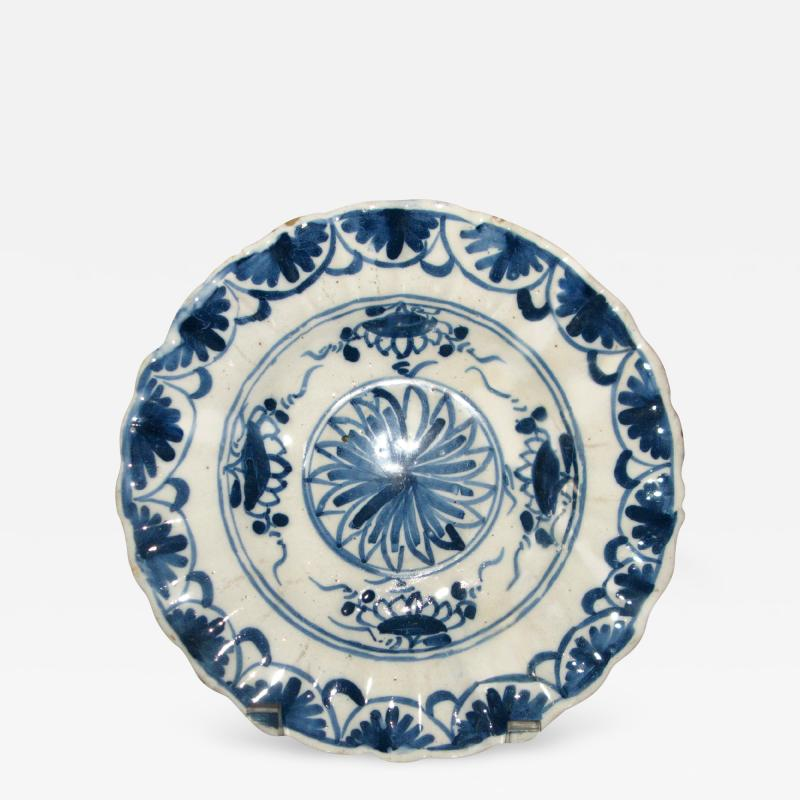 A Blue and White Delft Charger with Floral Splays and Scalloped Edge