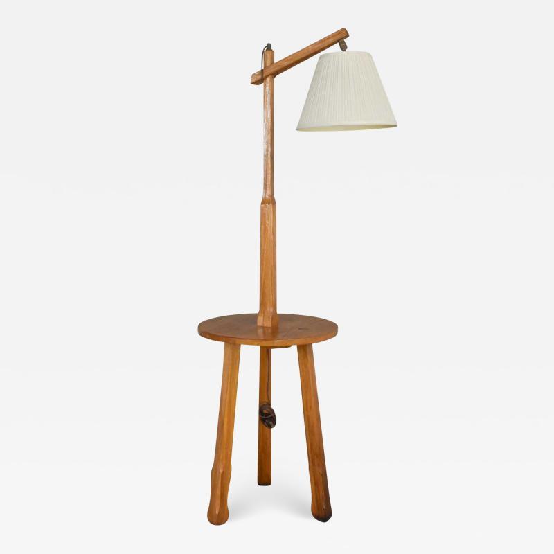 A Brandt Ranch Oak Furniture Vintage ranch oak adjustable arm floor lamp tri leg base with table by a brandt