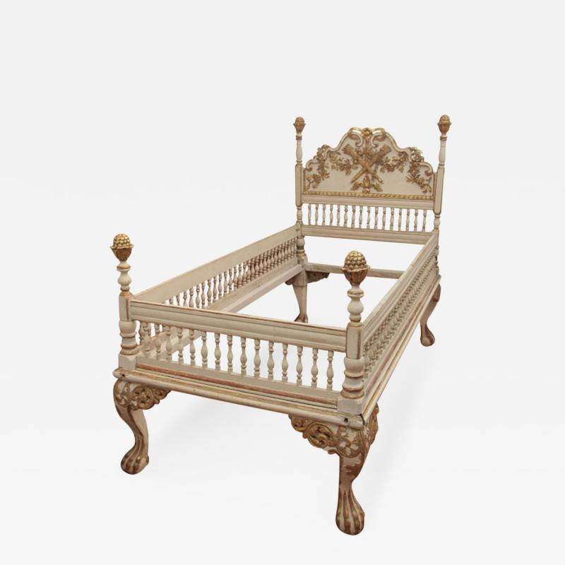 A Carved Painted and Gilded Wood Catalonian Bed