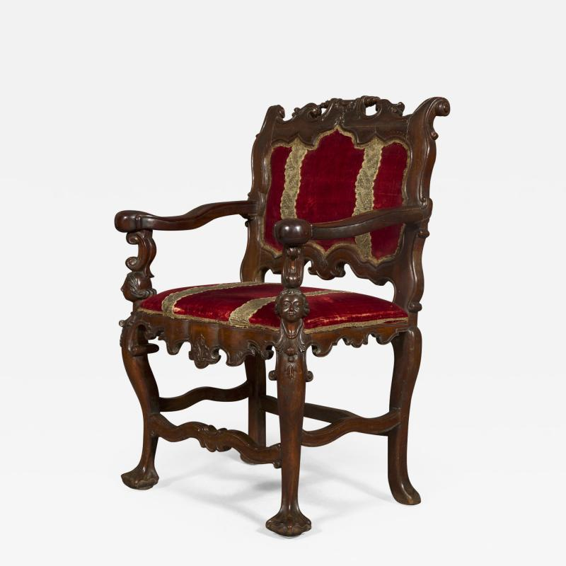 A Carved Rococo Period Hardwood Armchair Of Large Scale
