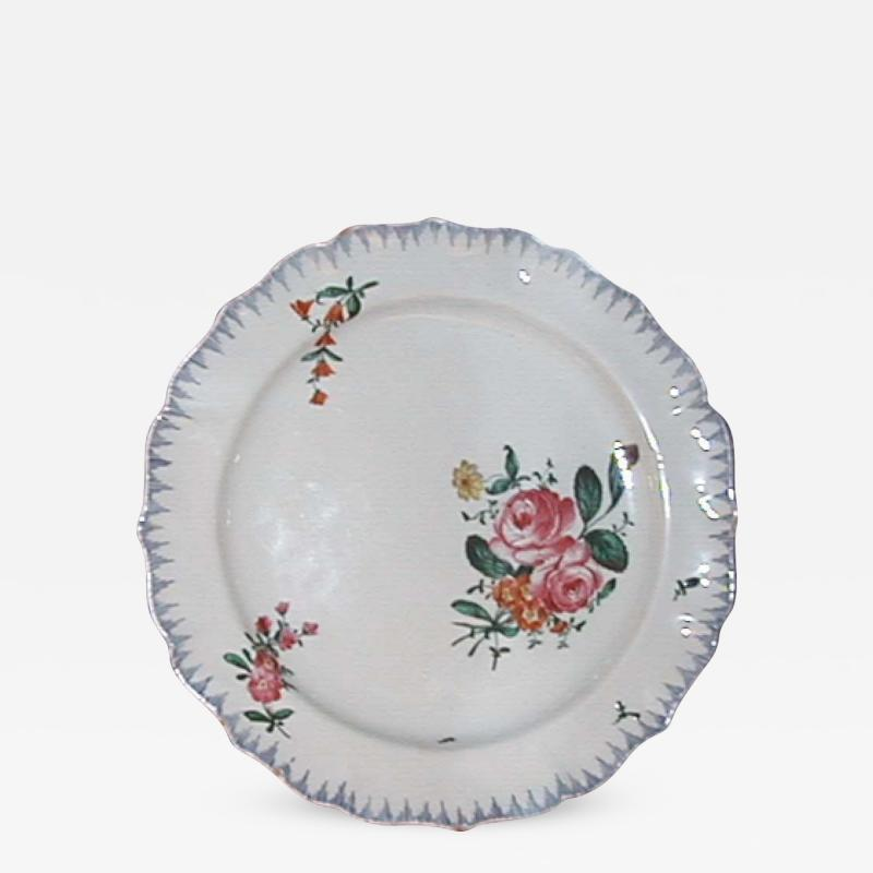 A Ceramic Plate with Painted Floral Decoration