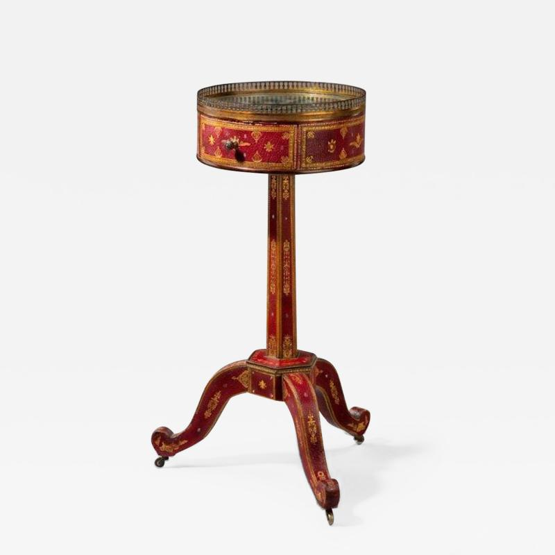 A Charles X Tooled leather Lamp Table