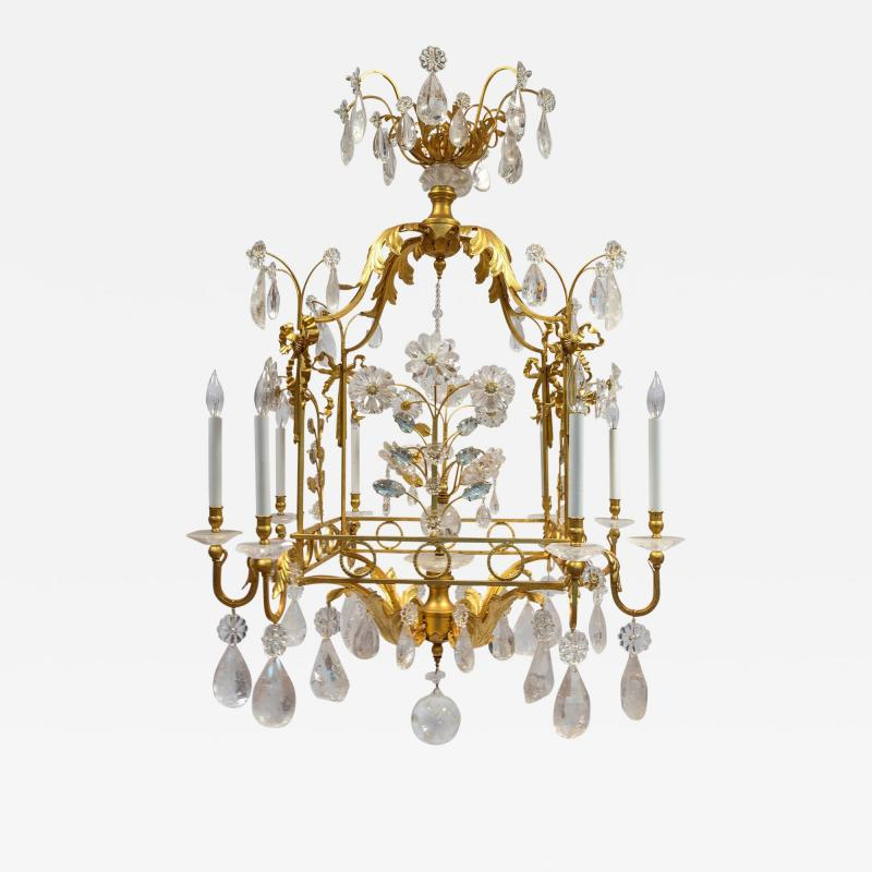 A Charming Gilt Metal and Rock Crystal Cage Formed Eight Light Chandelier