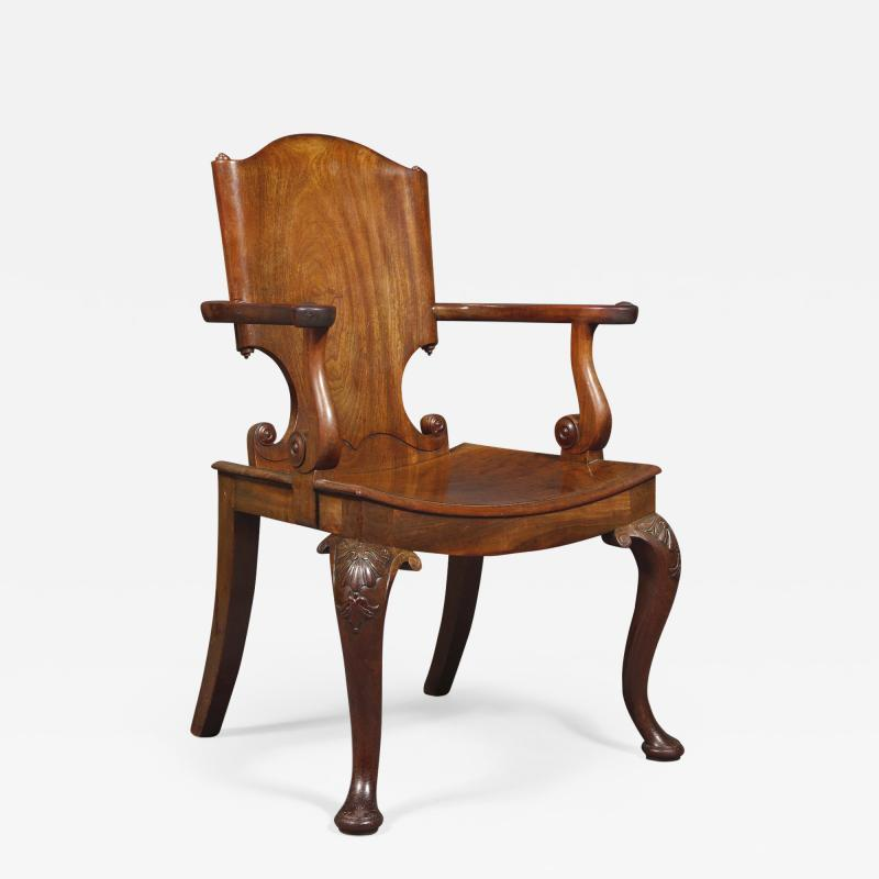 A Cuban Mahogany Armchair The Back In The Form Of A Paper Scroll