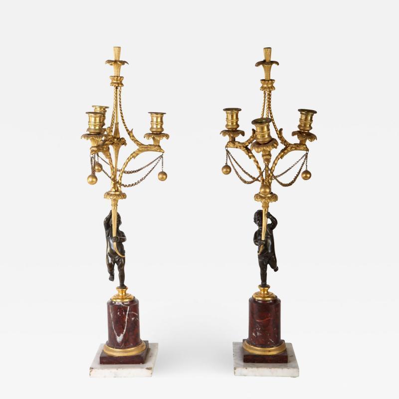 A Fine Pair of 18th Century Bronze and Gilt Bronze Candelabra