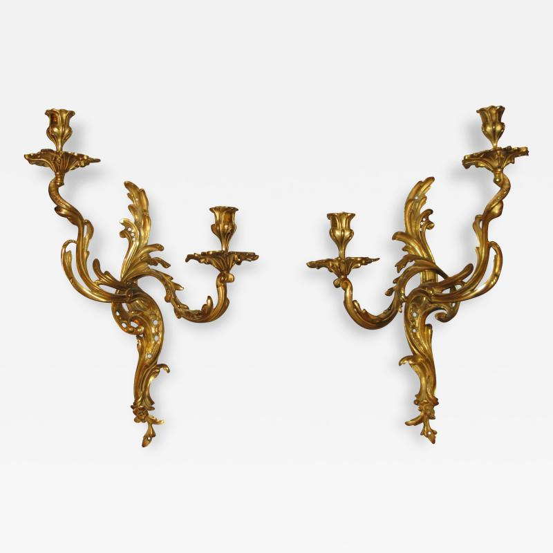 A Fine Pair of Chiseled and Chased Gilded Bronze Sconces