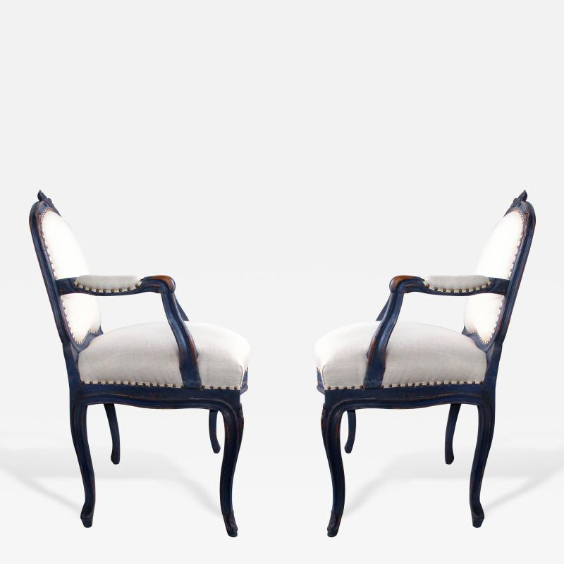 A Graceful Pair of French Rococo Blue Gray Painted Armchairs