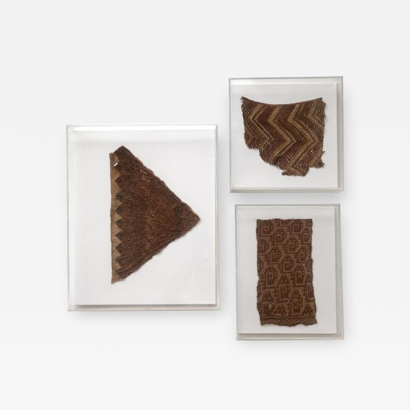 A Group of Three Framed Pre Columbian Textile Fragments