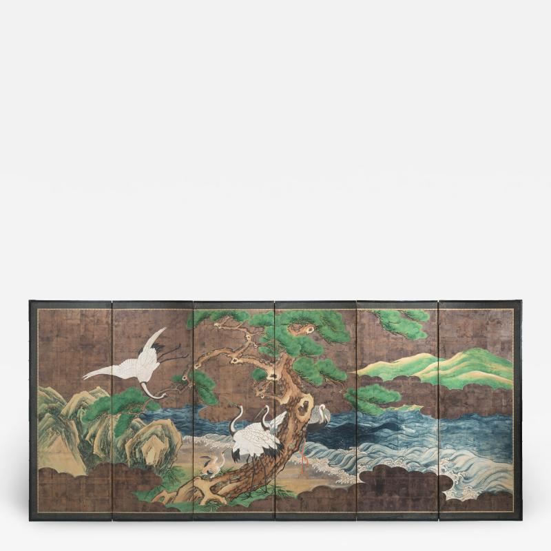 A Japanese 6 Panel Screen of Cranes Amidst Pine Trees by Water