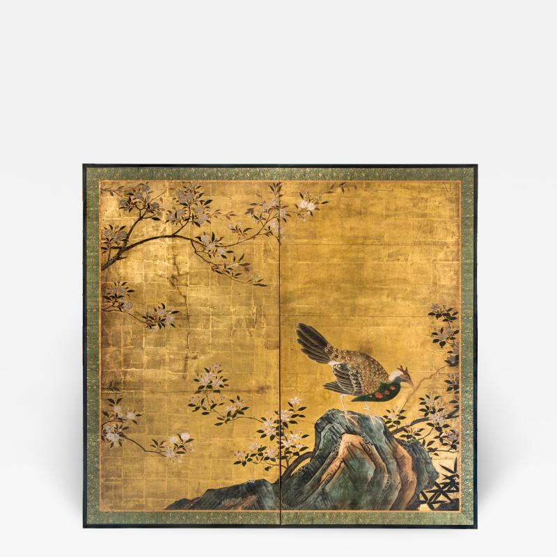 A Japanese Two Panel Screen of a Tragopan Standing on Rocks by Plum Blossoms