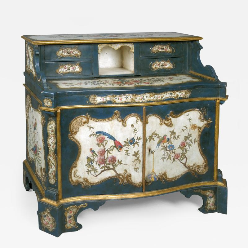 A Lacquered and Gilded Wood Cabinet and Desk