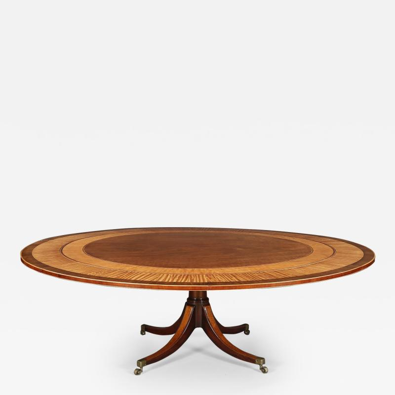 A Large And Elegant George III Dining Table Of Well Figured Mahogany