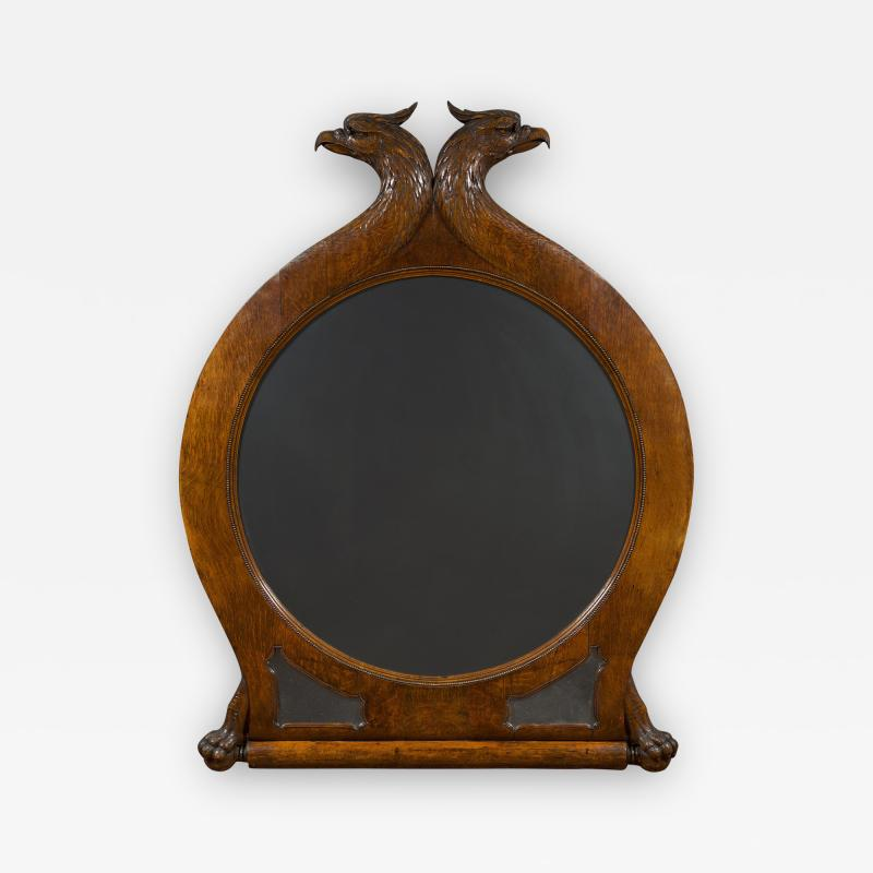 A Large Carved Oak Mirror Surmounted By Addorsed Eagle Heads