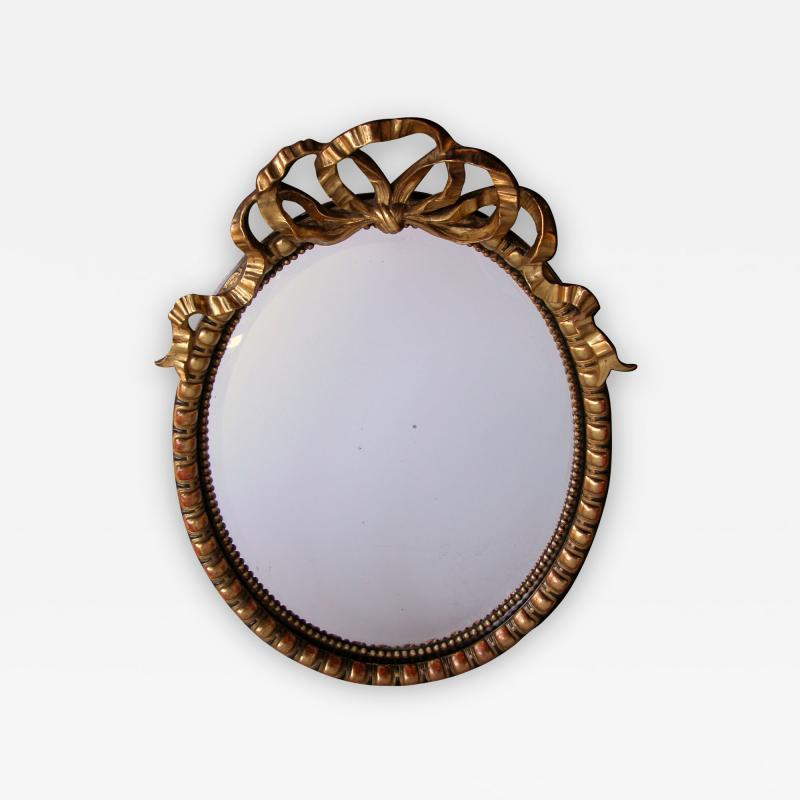 A Large Scaled Napoleon III Carved Oval Mirror