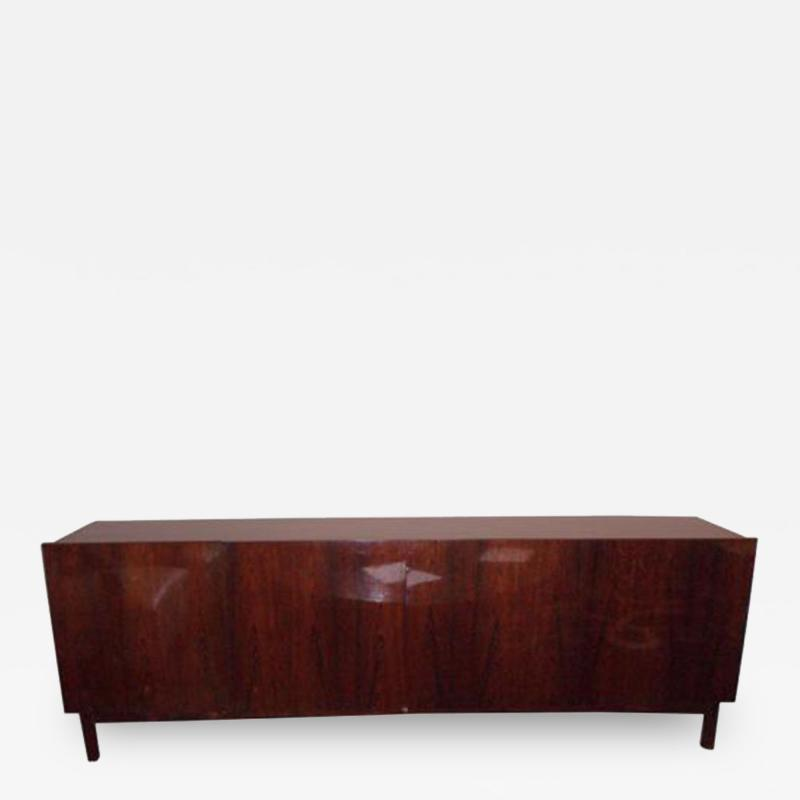 A Long Low Four Door Modernist Sideboard in Rosewood