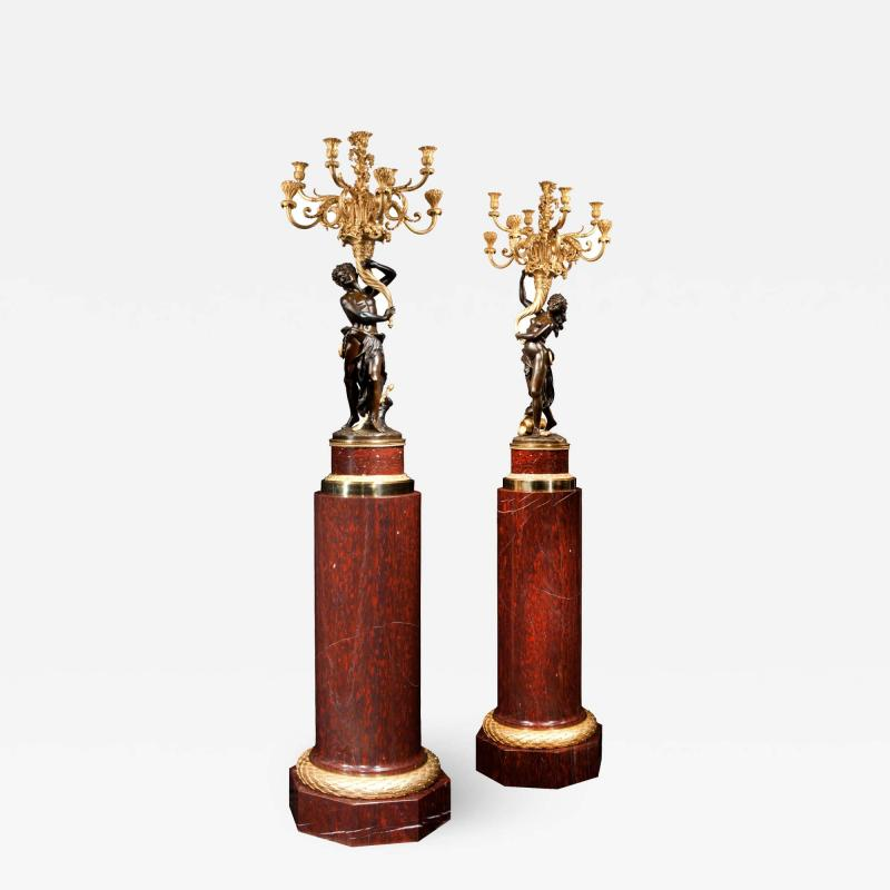 A Magnificent Pair of Louis XVI Candelabra after Clodion