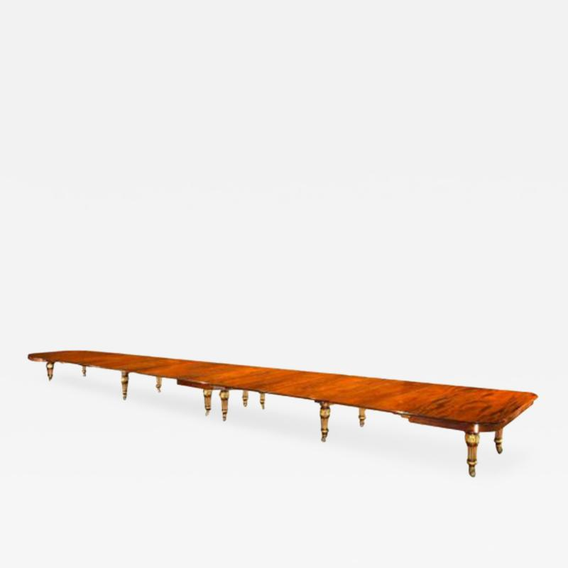 A Magnificent Royal Mahogany and Parcel Gilt Extension Dining Table c 1861