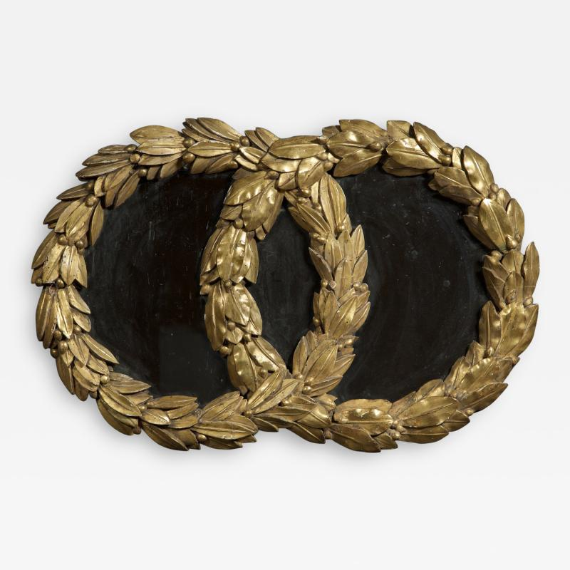 A Mirror in the form of Laurel Wreaths retaining its original gilding