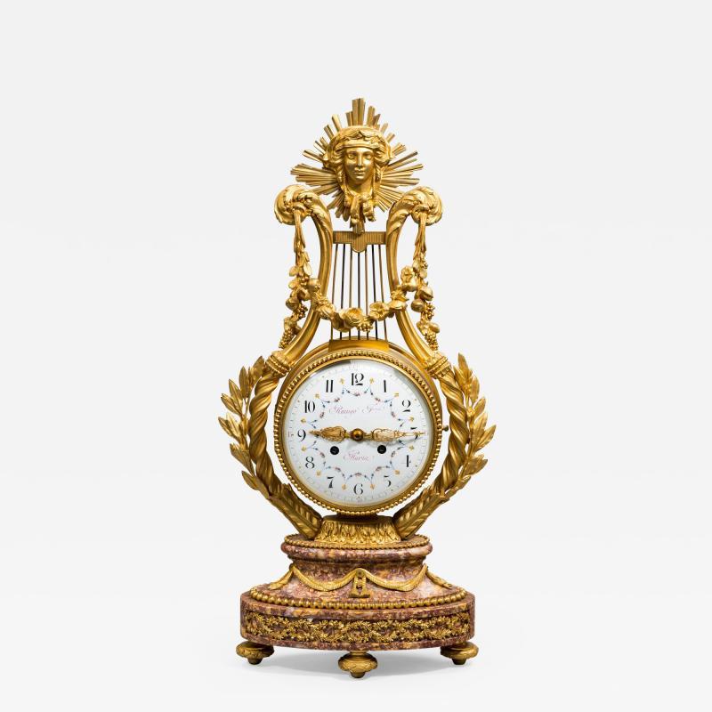 A Napoleon III Lyre clock with ormolu hand