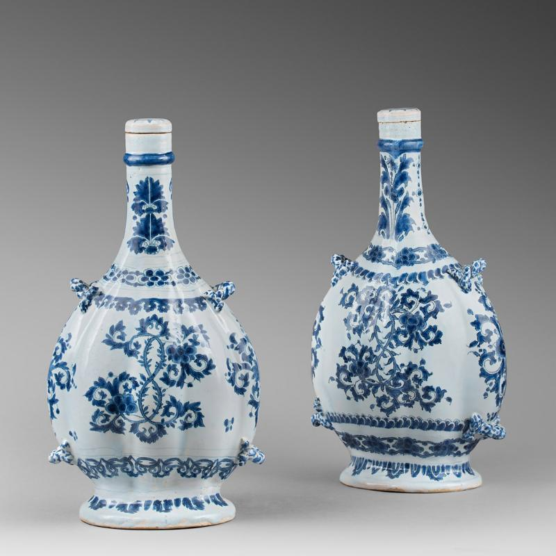 A Near Pair of 17th Century French Faience Gourd Shaped Bottles