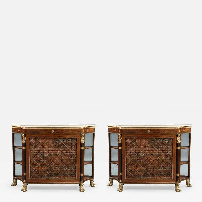A Pair Of Regency Library Cabinets With Giltwood Detailing And Faux Book Panels