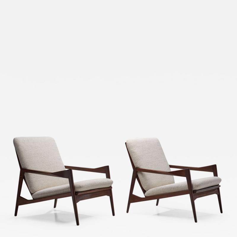 A Pair of Danish Ribbed Back Lounge Chairs Denmark 1960s