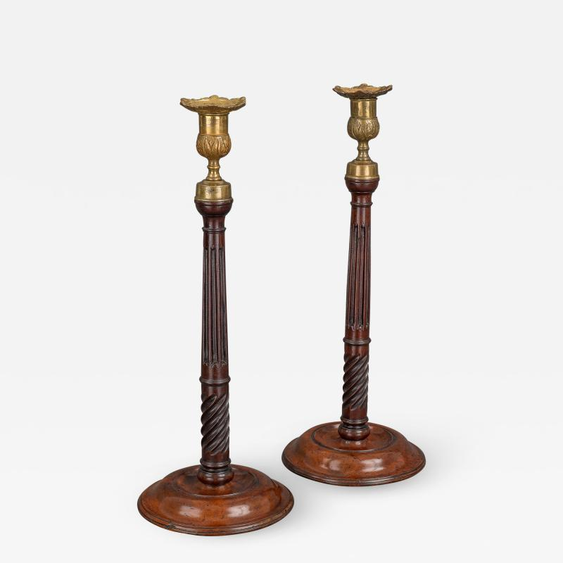 A Pair of George III Mahogany and Brass Candlesticks