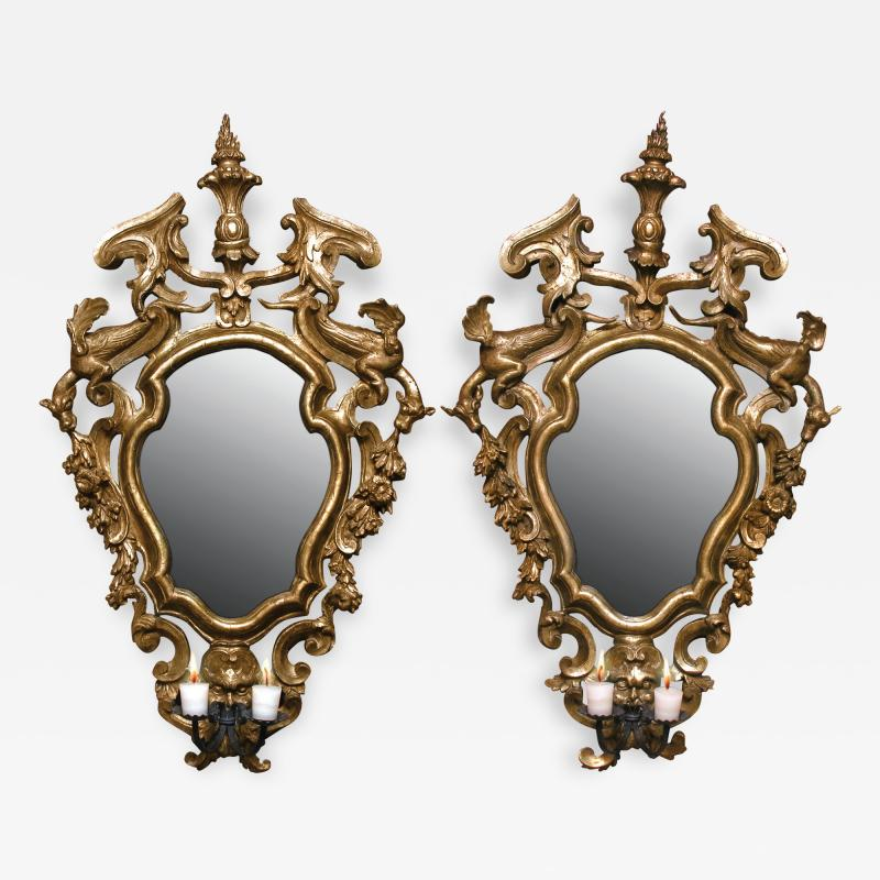 A Pair of Gilded Fir Wood Mirror Sconces with Wrought Iron Candle Arms