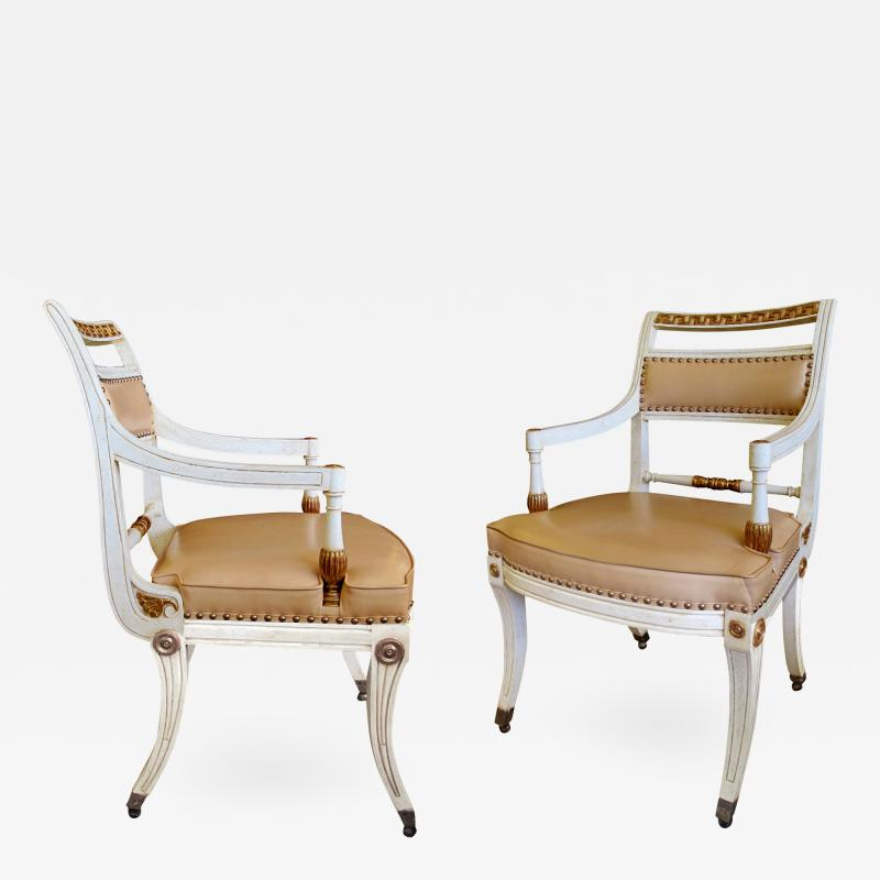 A Pair of Hollywood Regency Ivory Painted and Parcel Gilt Klismos Armchairs