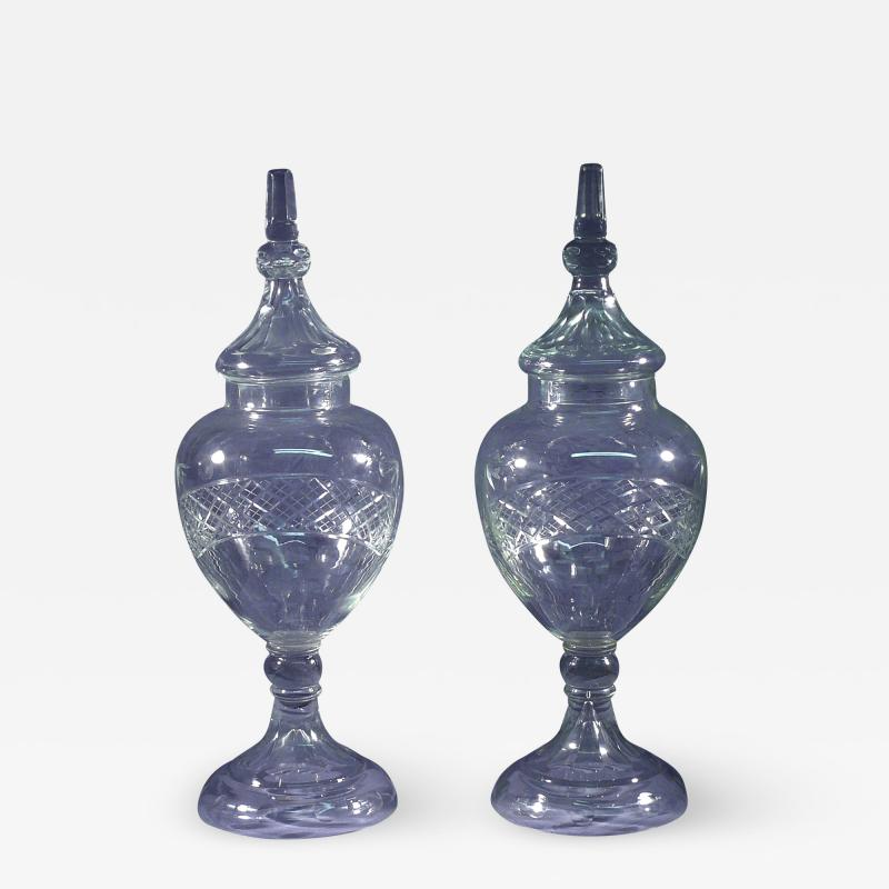 A Pair of Large Cut Glass Covered Apothecary Jars