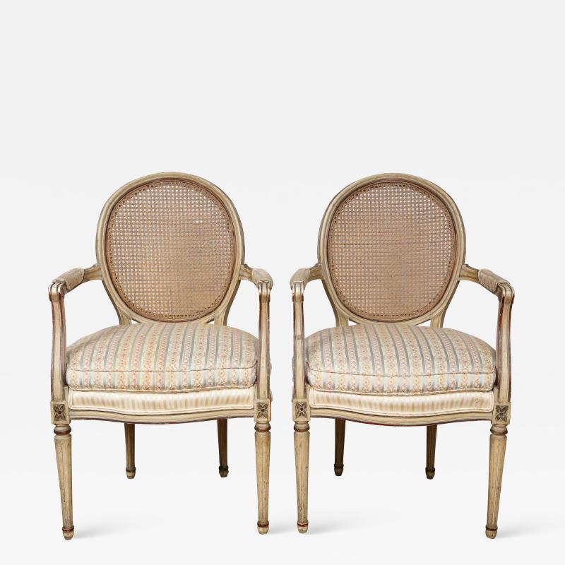 A Pair of Louis XVI Arm Chairs