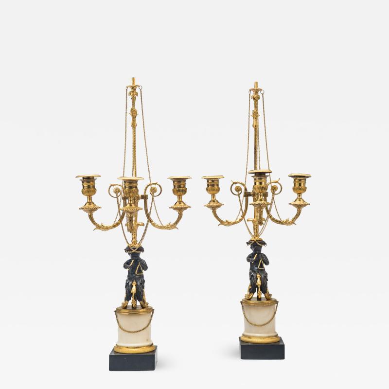 A Pair of Louis XVI Candelabra