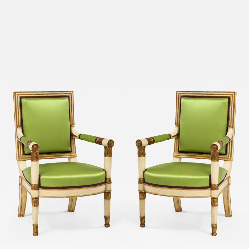 A Pair of Painted and Parcel Gilt Empire Armchairs