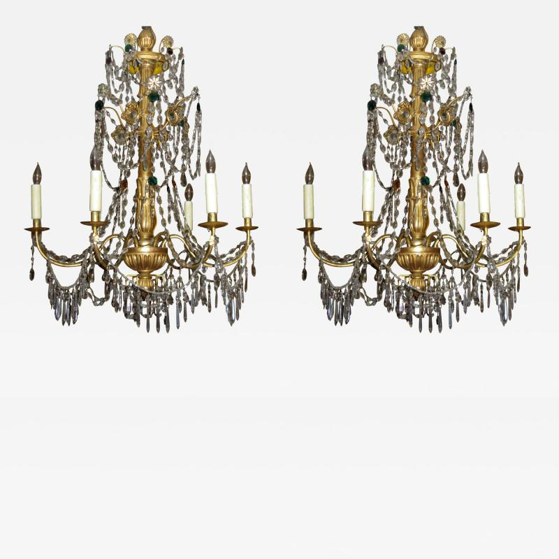 A Pair of Six Arm Carved and Gilded Wood Neoclassic Chandeliers