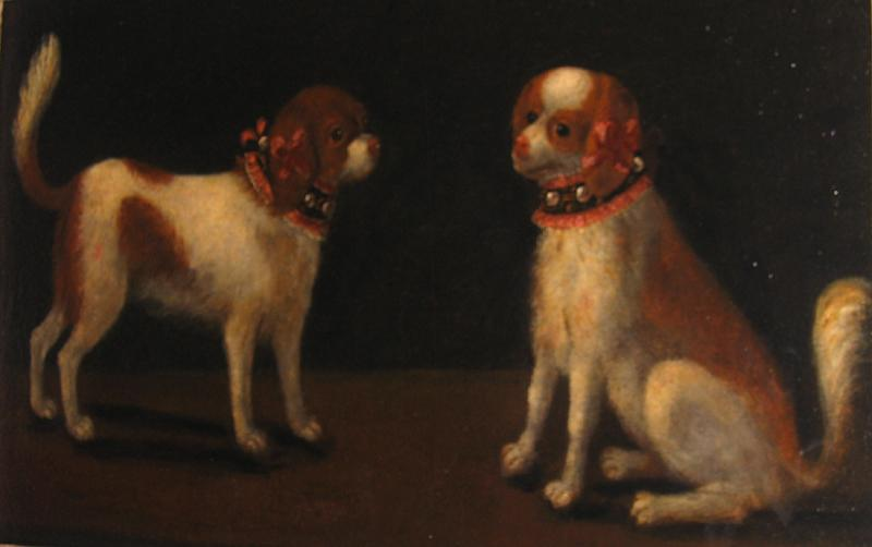 A Pair of Spaniels with Fanciful Collars of Lace Leather and Metal Studs