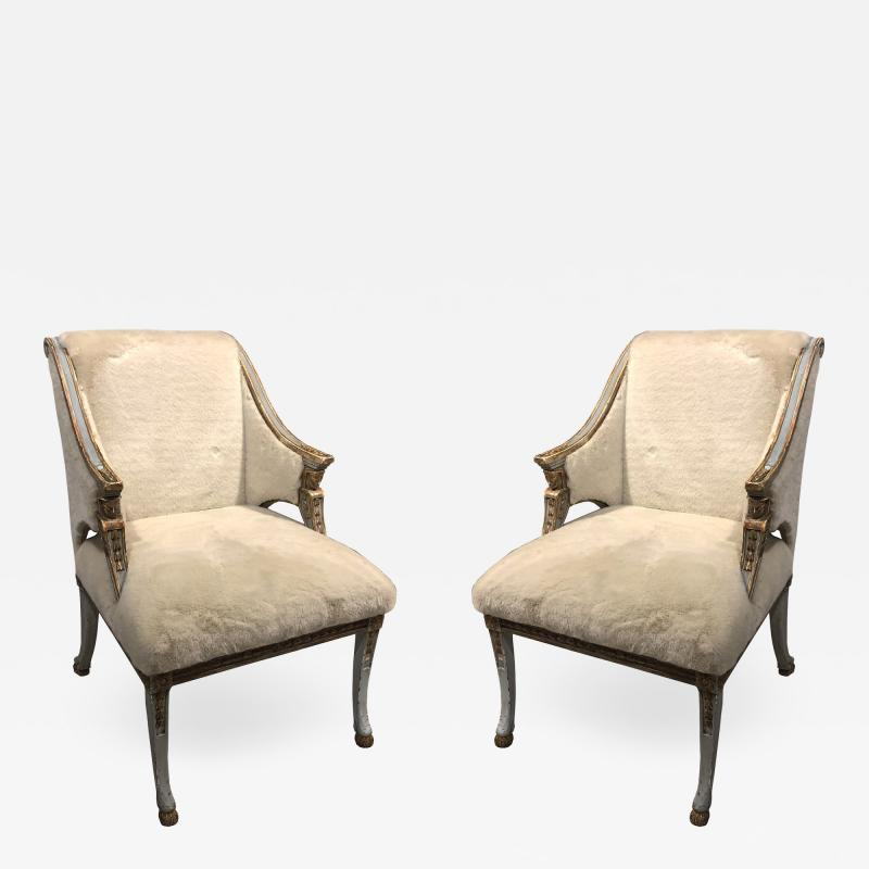 A Pair of Swedish Blue Painted and Silver Gilt Arm Chairs