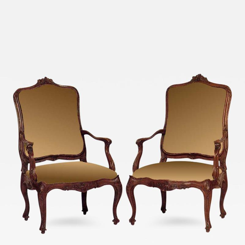 A Pair of Very Fine Italian Carved Walnut Armchairs