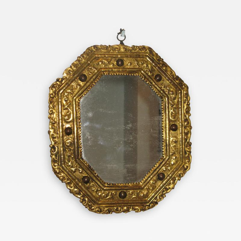A Rare Gilt Copper Repous e Octagonal Mirror with Inset Hard Stones
