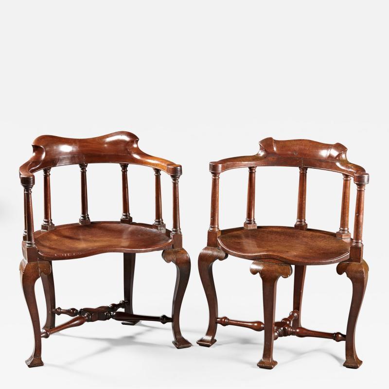 A Rare Pairing of Extraordinary George II English Walnut Windsor Armchairs