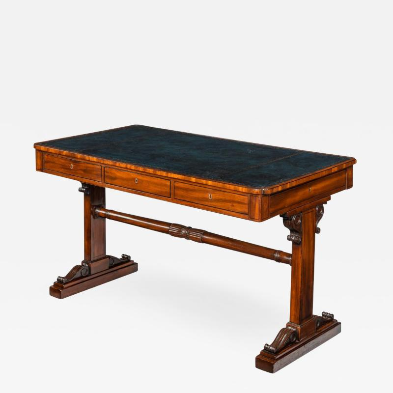 A Regency mahogany end support library table