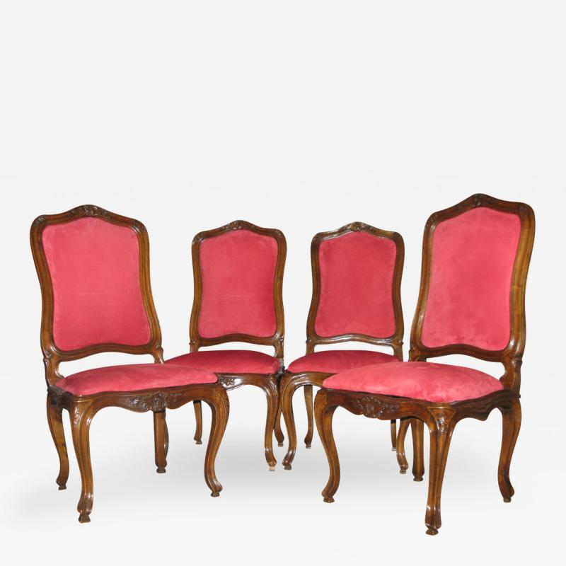 A Set of Four Walnut and Red Velvet Side Chairs