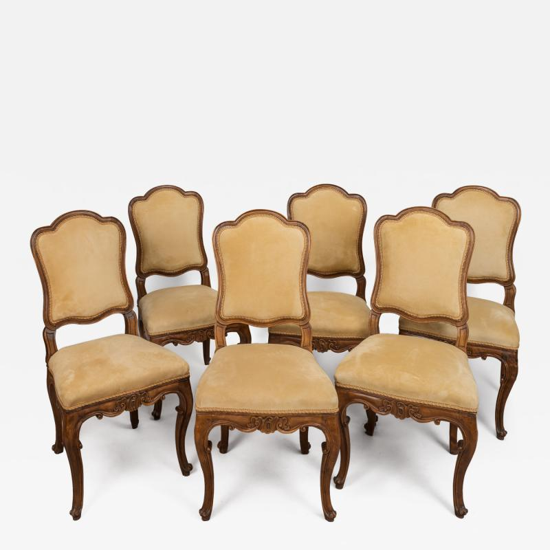 A Set of Six Italian Walnut Side Chairs with Cartouche Shaped Backs